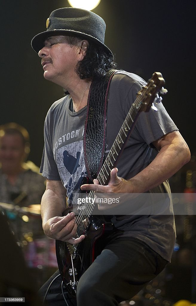 Mexican-American musician Carlos Santana performs on stage during the 38th edition of the North Sea Jazz festival in Rotterdam on July 12, 2013. The festival runs from today until 14 July. AFP PHOTO/ANP/PAUL BERGEN netherlands out