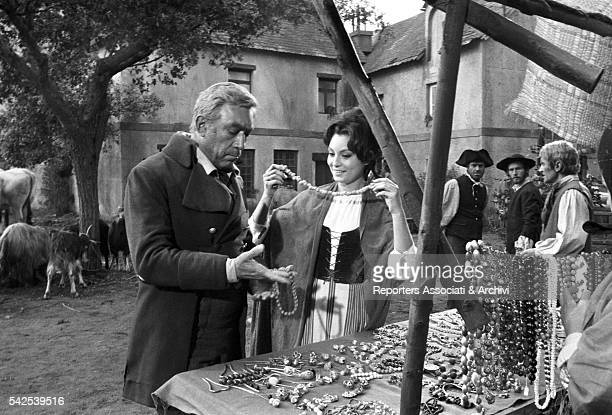 Mexicanborn American actor Anthony Quinn and Italian actress Rosanna Schiaffino choosing jewels in The Rover 1967