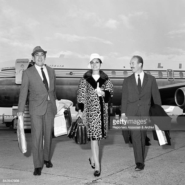 Mexicanborn American actor Anthony Quinn and Italian actress Rosanna Schiaffino next to her husband Italian producer Alfredo Bini at Fiumicino...