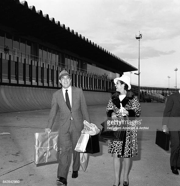 Mexicanborn American actor Anthony Quinn and Italian actress Rosanna Schiaffino at Fiumicino airport Fiumicino 1967