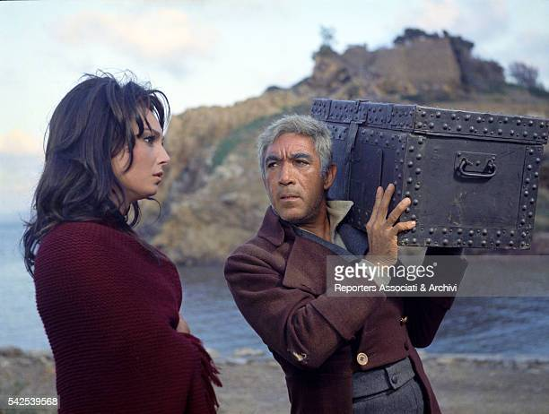 Mexicanborn American actor Anthony Quinn carrying a casket next to Italian actress Rosanna Schiaffino in The Rover 1967