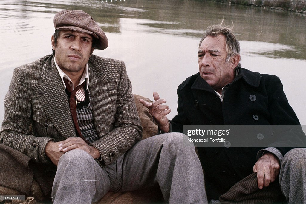 Mexicanborn American actor Anthony Quinn talking to Italian actor and singersongwriter Adriano Celentano in the film The Con Artists Monte Carlo 1976