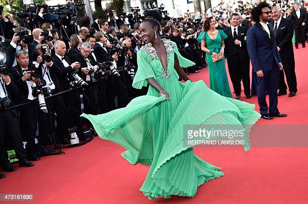 MexicanKenyan actress Lupita Nyong'o poses as she arrives for the opening ceremony of the 68th Cannes Film Festival in Cannes southeastern France on...