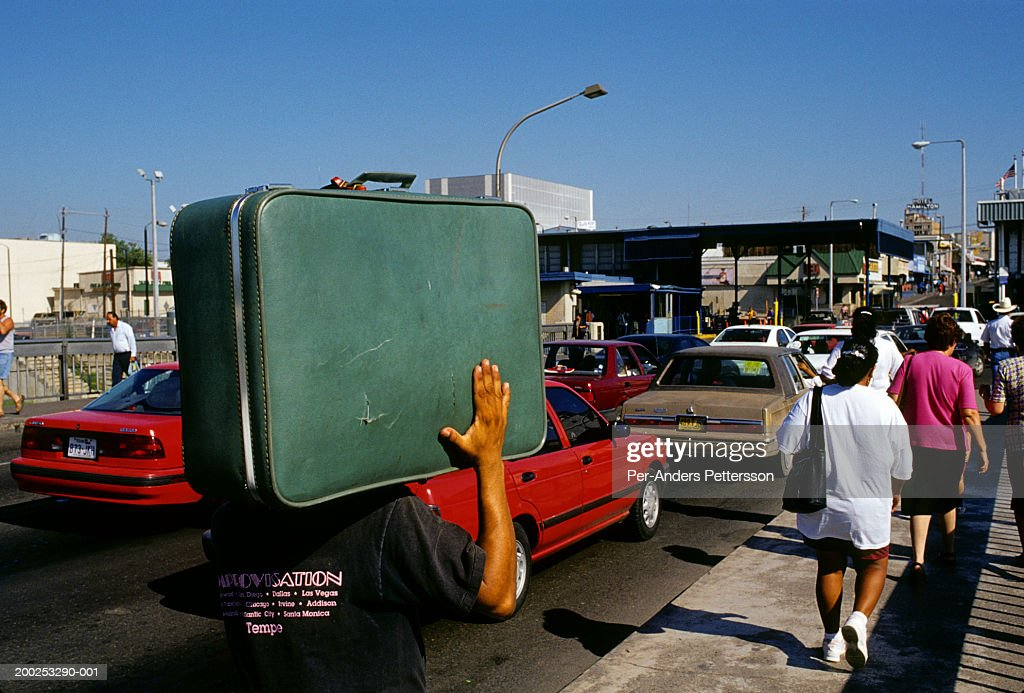 Mexicans cross border post at Laredo, Texas into the United States : Stock Photo