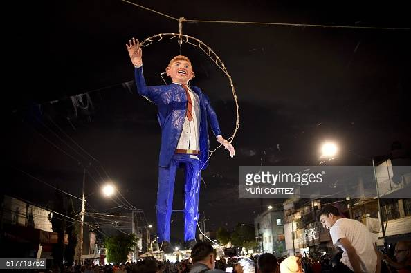 Mexican's hang an effigy representing US Republican presidential candidate Donald Trump before being set on fire March 26 2016 in Mexico City during...