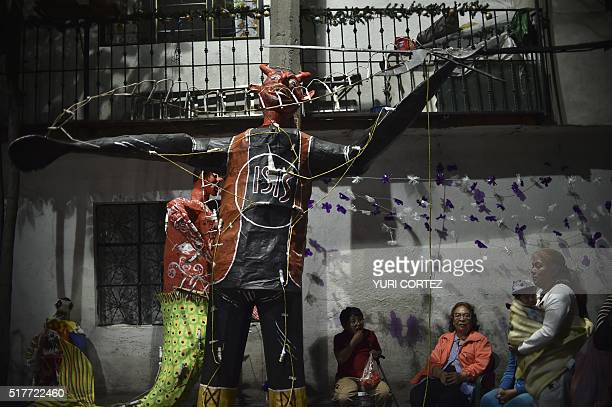 Mexican's prepare to set fire to an effigy depicting the Islamic State group during Holy Week celebrations in Mexico City on March 26 2016 For many...