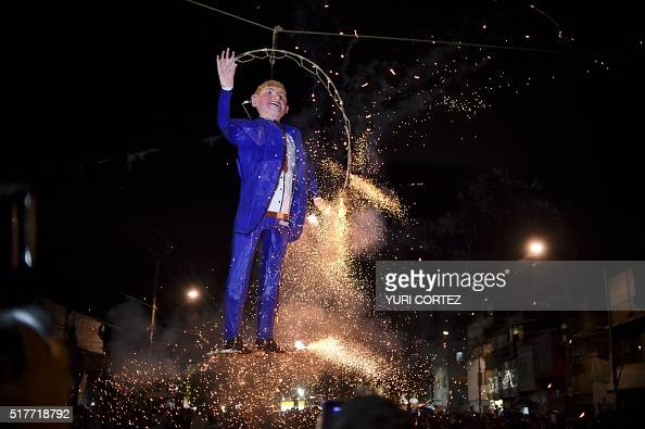 Mexican's set fire to an effigy of US Republican presidential candidate Donald Trump on March 26 2016 in Mexico City during Holy Week celebrations...