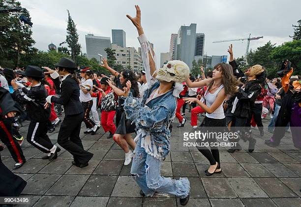 Mexicans take part in the 'I do dance Thriller' event which attempts to break the Guinness World Record for the biggest mass 'Thriller' dance in...