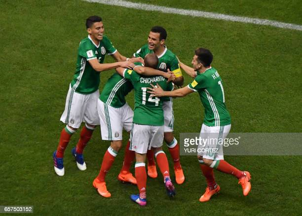Mexicn players celebrate a goal of their team during their 2018 FIFA World Cup qualifier football match against Costa Rica in Mexico City on March 24...