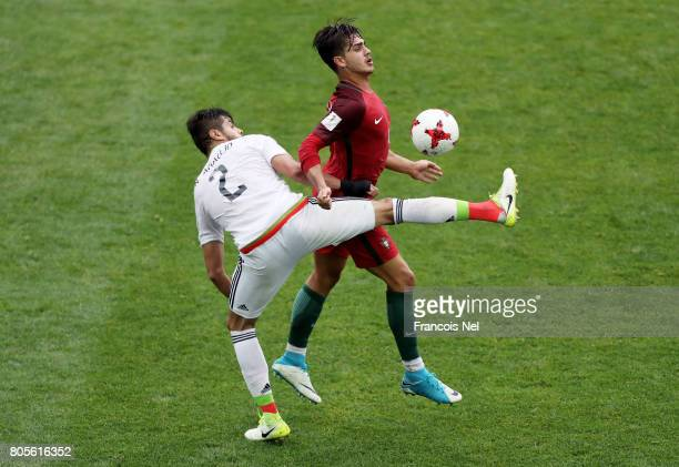 Mexico and Andre Silva of Portugal battle for possession during the FIFA Confederations Cup Russia 2017 PlayOff for Third Place between Portugal and...
