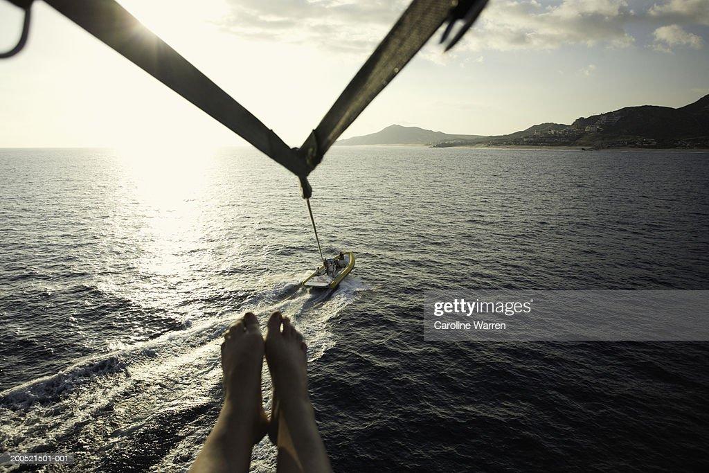 'Mexico, Baja, Cabo San Lucas, mature woman parasailing, low section' : Stock Photo