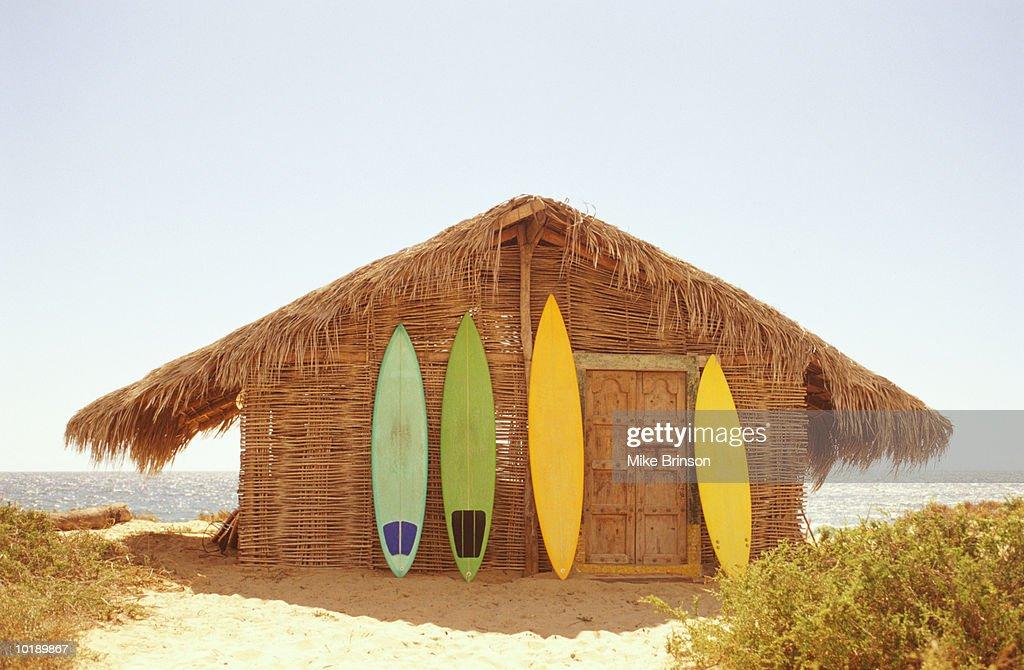 Mexico, Baja California, surfboards leaning against beach shack