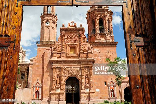 Mexico Bajio Zacatecas Monastery and Church of Guadalupe seen through opening in entrance gates