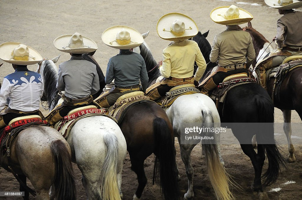 Mexico Bajio Zacatecas Traditional horsemen or Charros standing mounted in line watching the competition at Mexican rodeo