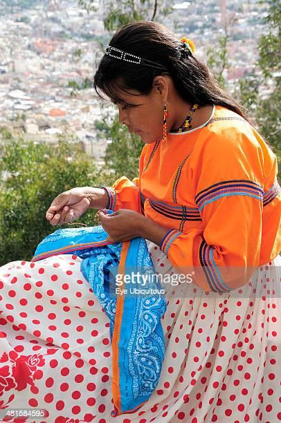 Mexico Bajio Zacatecas Young woman sewing handicrafts at Cerro de la Buffa