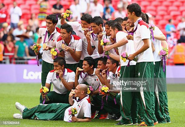 Mexico celebrate after they defeated Brazil at the Men's Football Gold Medal match between Brazil and Mexico on Day 15 of the London 2012 Olympic...