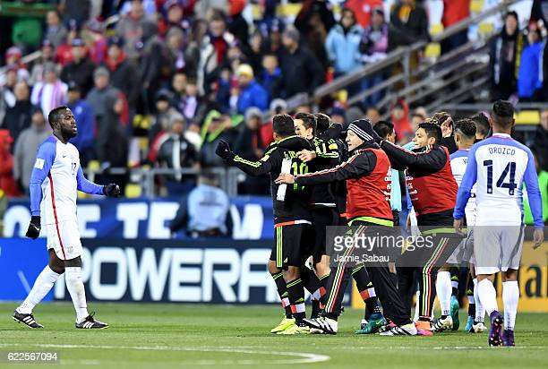 Mexico celebrates after defeating the United States 21 while Jozy Altidore of the United States looks on during the FIFA 2018 World Cup Qualifier at...
