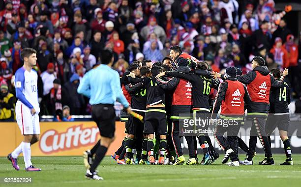 Mexico celebrates after defeating the United States 21 while Christian Pulisic of the United States looks on during the FIFA 2018 World Cup Qualifier...
