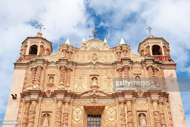Mexico, Chiapa, San Cristobal de Las Casas, Facade of Santo Domingo church against cloudy sky