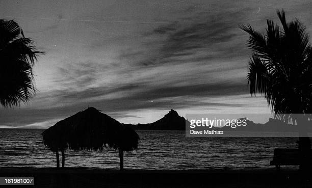 JAN 7 1965 JAN 10 1965 Mexico * Cities * Guaymas Seashore near Guaymas Mexico provides idyllic scene at sunset