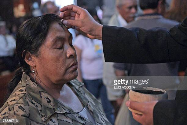 A Catholic devotee gets the ash cross on her forehead during the Ash Wednesday celebration 21 February 2007 in Mexico City AFP PHOTO/Luis ACOSTA