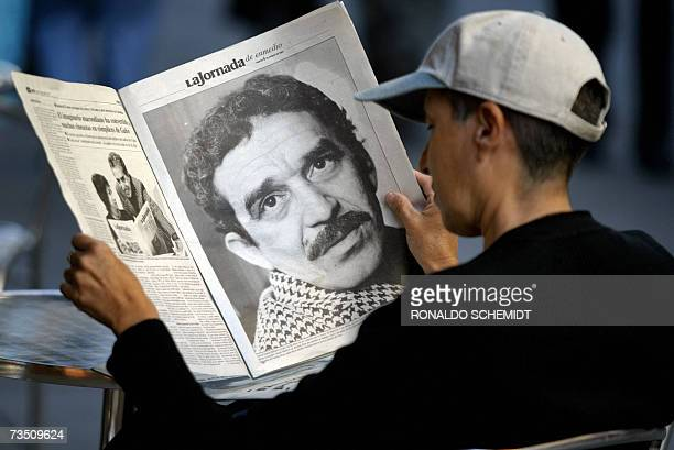 A young Mexican sitting in a cafe reads a newspaper which offers a special suplement dedicated to Colombian writer and Nobel Prize in Literature 1982...