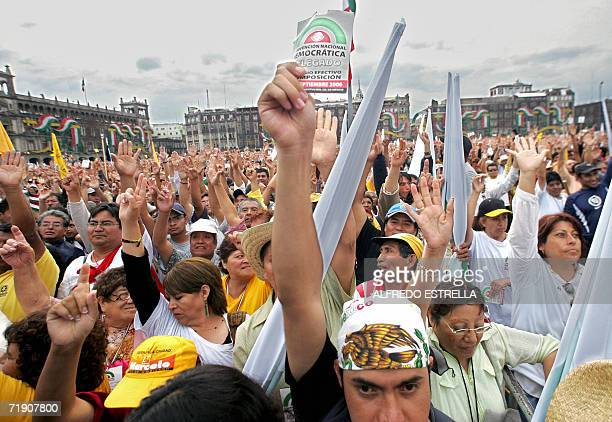 Delegates and supporters of Mexican leftist former presidential candidate Andres Manuel Lopez Obrador raise their hands to vote during the National...