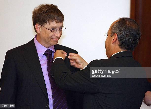Mexican President Felipe Calderon decorates Bill Gates chairman of Microsoft with the Aztec Eagle Order the highest decoration of the Mexican...