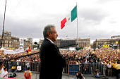 Mexican presidential candidate Andres Manuel Lopez Obrador of the Democratic Revolutionary Party speaks at the Zocalo Square in Mexico City 08 July...