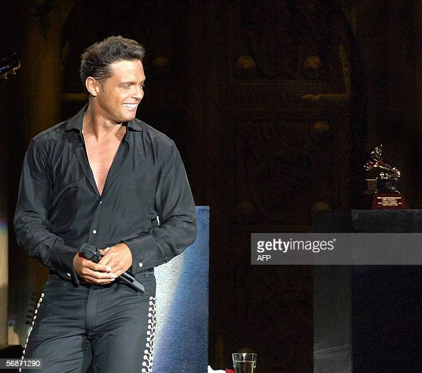 Mexican singer Luis Miguel looks at his Grammy award after his tour concert 'Con Mexico en la Piel' at the National Auditorium in Mexico City 17...