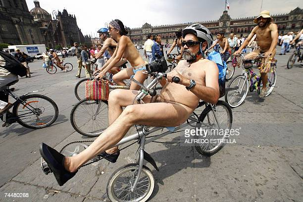 Naked demonstrators ride their bicycles at the Zocalo Square in Mexico City 09 June 2007 as part of the World Naked Bike Ride Nude cyclists are...