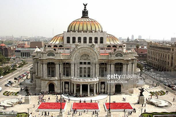 Picture of Mexico City's Fine Arts Palace 10 May 2006 in front of where 60000 artificial poppies have been placed by the Japanese brand Kenzo as part...