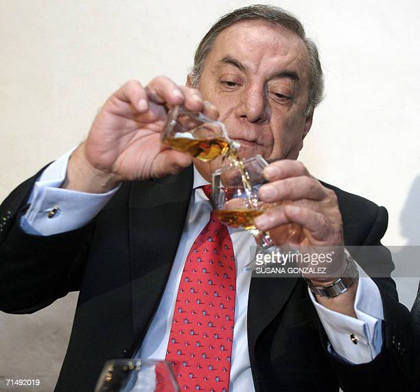 Rafael Selva serves a glass of a '925' Tequila bottle which is one of the most expensive brand of tequilas in Mexico city 20 July 2006 The tequila...
