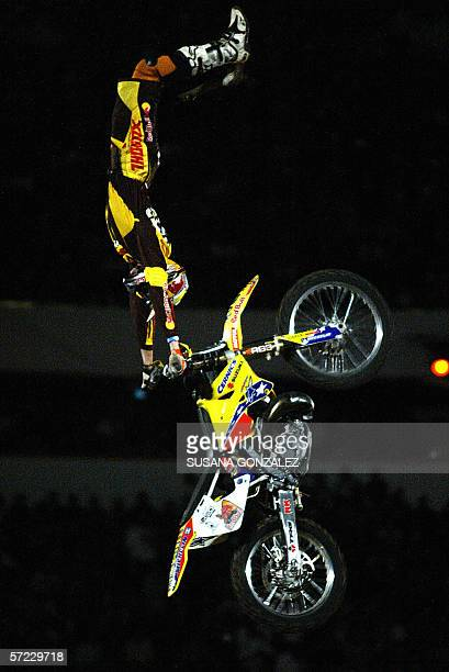 US motorcyclist Travis Pastrana performs during the freestyle motocross show 'Red Bull X Fighters' at the Bull ring in Mexico City 31 March 2006 AFP...