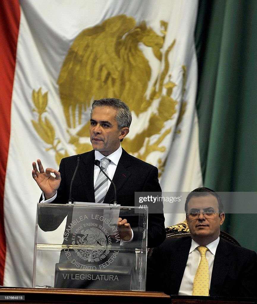 Mexico City new Mayor Miguel Angel Mancera speaks during his inauguration at the local congress in Mexico City, on December 5, 2012. Mancera replaces Marcelo Ebrard (R). AFP PHOTO/Guillermo Ogam