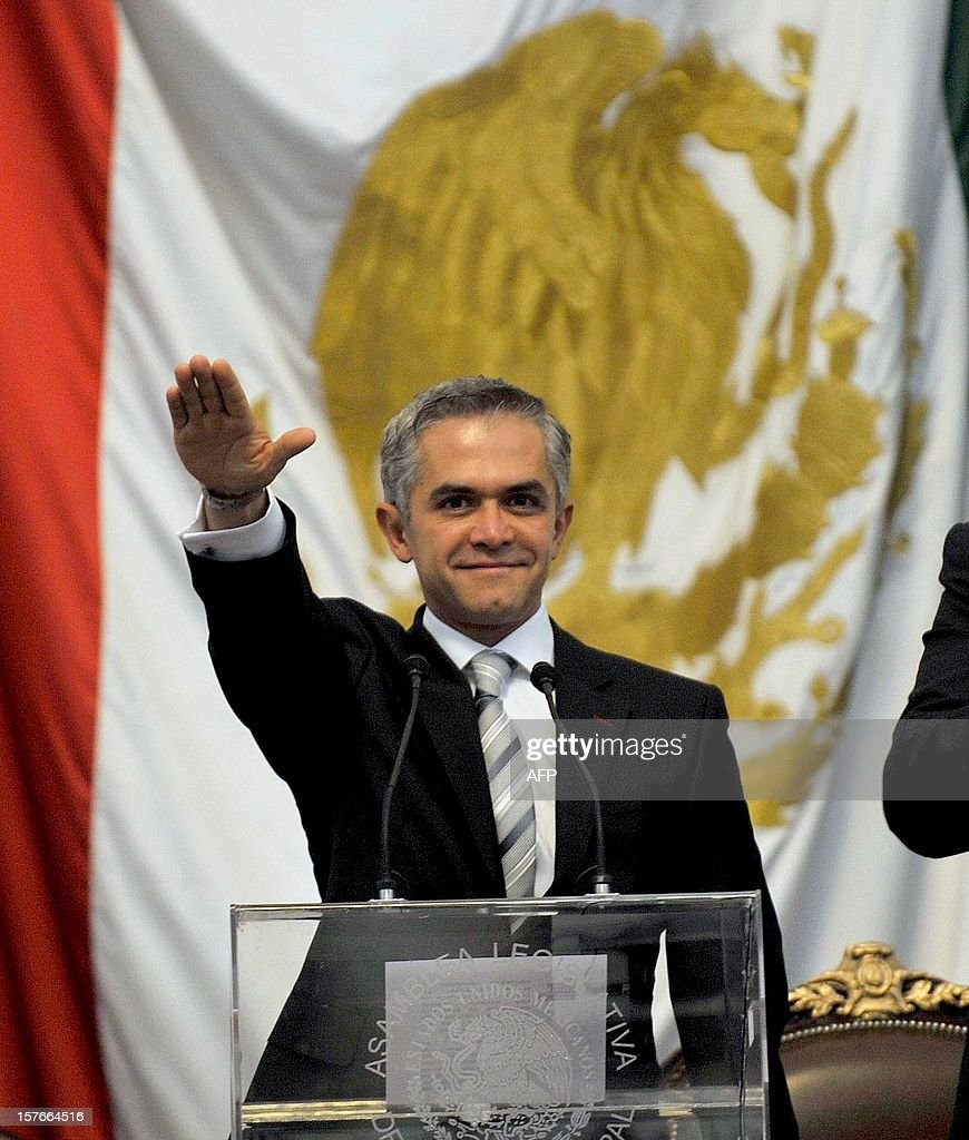 Mexico City new Mayor Miguel Angel Mancera takes the constitutional oath during his inauguration at the local congress in Mexico City, on December 5, 2012. Mancera replaces Marcelo Ebrard. AFP PHOTO/Guillermo Ogam