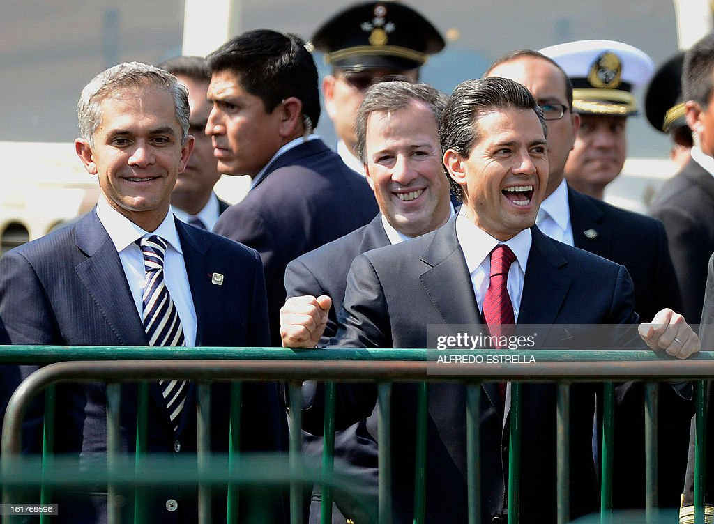 Mexico City's Mayor Miguel Mancera, Mexican Foreign Minister Antonio Meade and Mexican President Enrique Pena Nieto smile during a tour of the exhibition 'Armed Forces, Pride for Serving Mexico' at Zocalo Square in Mexico City, following a ceremony involving the Armed Foreces, on February 15, 2013. AFP PHOTO/Alfredo ESTRELLA