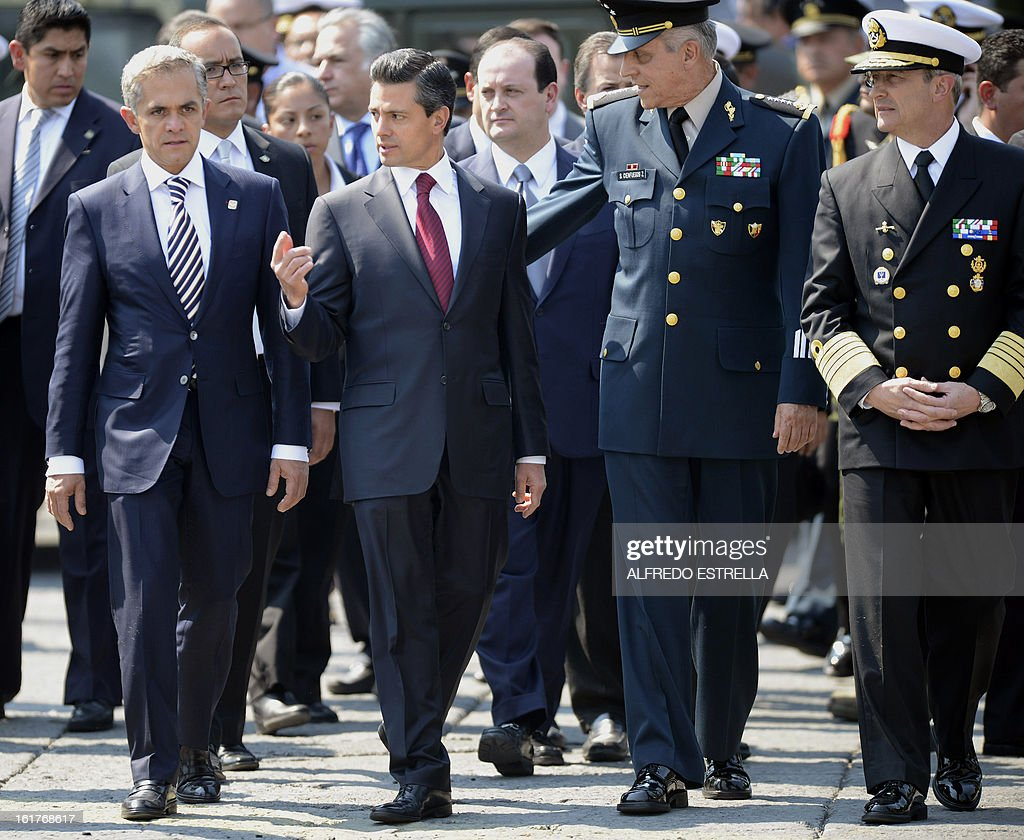 Mexico City's Mayor Miguel Mancera, Mexican President Enrique Pena Nieto, Defence Secretary General Salvador Cienfuegos and the Secretary of the Mexican Navy Francisco Soberon are pictured during a tour of the exhibition 'Armed Forces, Pride for Serving Mexico' at Zocalo Square in Mexico City, following a ceremony involving the Armed Foreces, on February 15, 2013. AFP PHOTO/Alfredo ESTRELLA