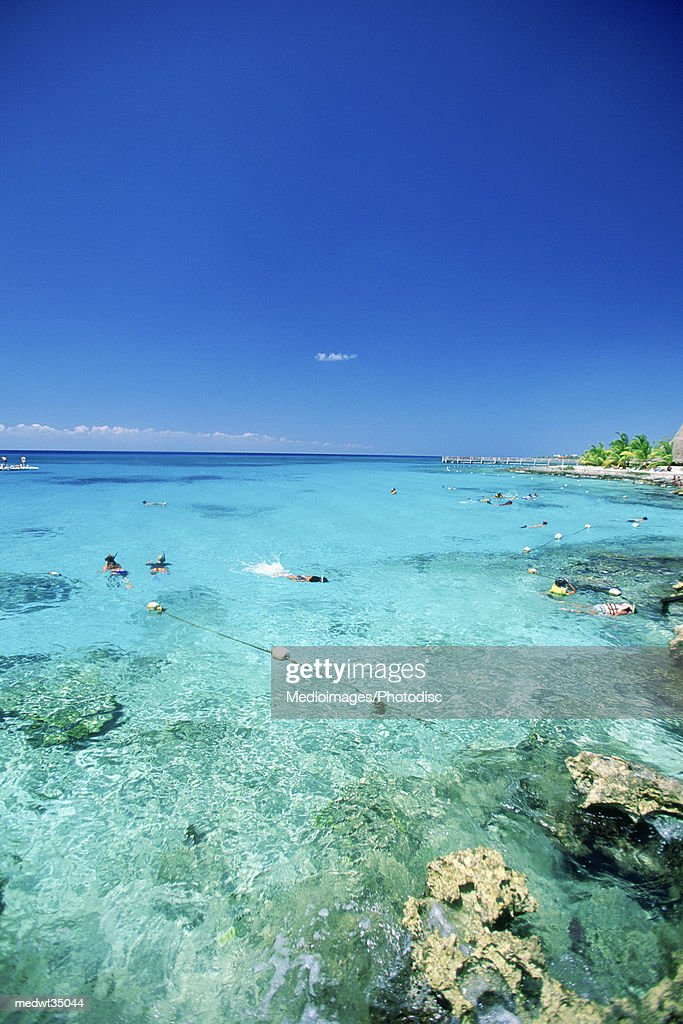 Mexico, Cozumel, Chankanaab National Park, People swimming in the sea : Stock Photo