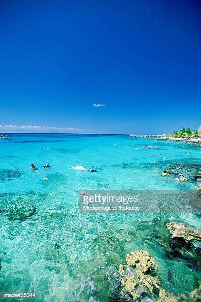 Mexico, Cozumel, Chankanaab National Park, People swimming in the sea