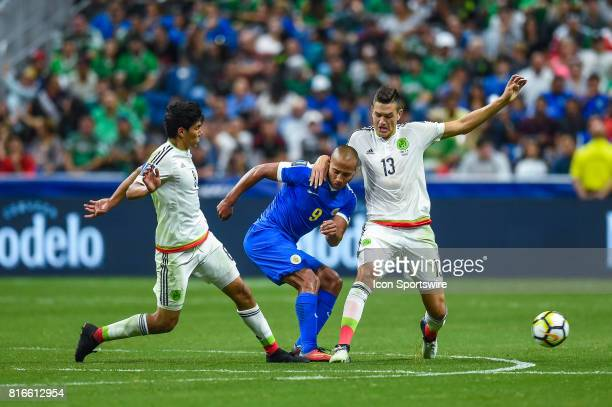 Mexico defender César Montes and Curacao forward Gino Van Kessel fight for the ball during the CONCACAF Gold Cup soccer match between Curacao and...