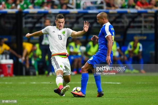 Mexico defender César Montes and Curacao forward Gino Van Kessel fight for control of the ball during the CONCACAF Gold Cup soccer match between...