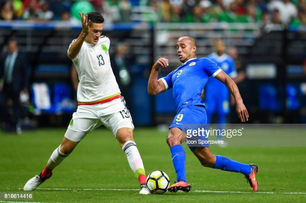 Mexico defender César Montes and Curacao forward Gino Van Kessel battle for a ball during the CONCACAF Gold Cup soccer match between Curacao and...