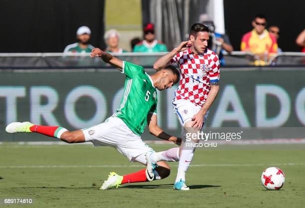 Mexico defender Diego Reyes and Croatia forward Duje Cop battle for the ball during the first half of a national friendly soccer game at LA Memorial...