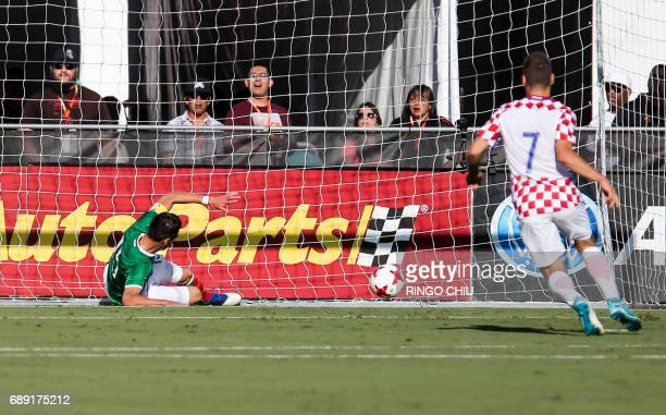 Mexico defender Hector Moreno left unable to make a save during the first half of a national friendly soccer game against Croatia at LA Memorial...
