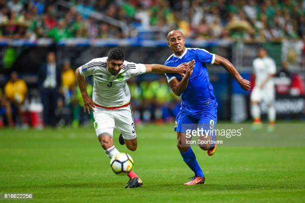 Mexico defender Jair Pereira and Curacao forward Gino Van Kessel battle for a ball during the CONCACAF Gold Cup soccer match between Curacao and...
