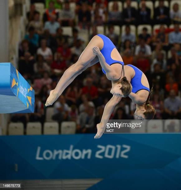 Mexico divers Paola Espinosa Sanchez and Alejandra Loza Orozco launch into a forward dive during the first round of the women's synchronized 10m...