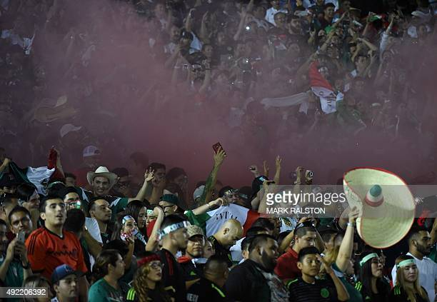 Mexico fans celebrate after winning during their 2015 CONCACAF Cup match against the USA at the Rose Bowl in Pasadena California on October 10 2015...