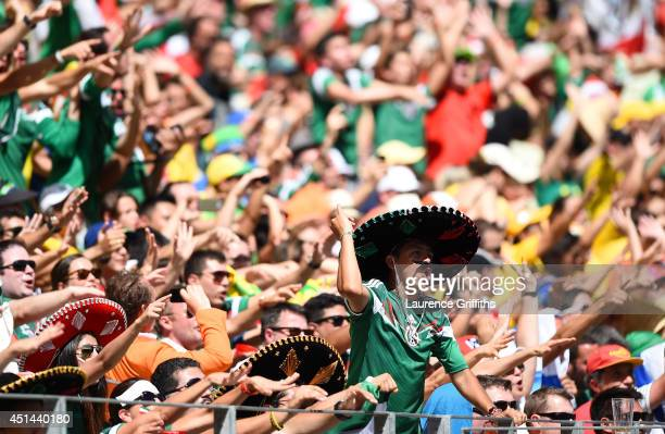 Mexico fans cheer during the 2014 FIFA World Cup Brazil Round of 16 match between Netherlands and Mexico at Castelao on June 29 2014 in Fortaleza...