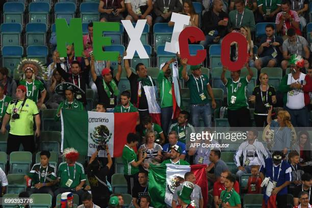 Mexico fans cheer during the 2017 Confederations Cup group A football match between Mexico and New Zealand at the Fisht Stadium in Sochi on June 21...
